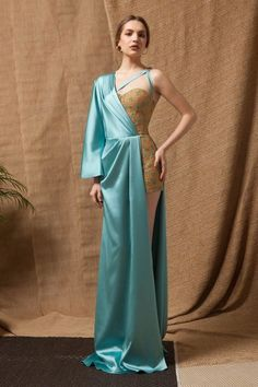 Turquoise Satin open-side Dress with underlying Gold Hand-beaded Corset Jumpsuit; and Asymmetrical Satin straps. Couture Fashion, Runway Fashion, Prom Dress Couture, Geometric Fashion, Stylish Dress Designs, Fantasy Dress, Jumpsuit Dress, Beautiful Gowns, Classy Outfits