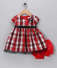 Perfectly poufy and perfectly plaid, this charming frock will look smartly sweet on any little lady. With soft lining, layers of tulle and handy back buttons, this piece is one genius style choice. By Joe-EllaIncludes dress and bloomers100% polyesterMachine wash