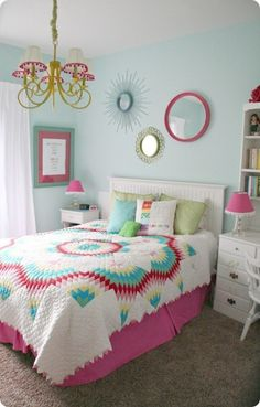 Pink, blue, and green room. Don't like the quilt at all, but I love the color mixture!