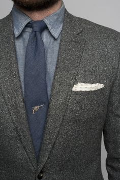 Nice jacket with revolver tie pin