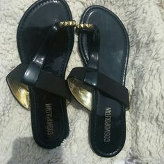 Cosmopolitan black sandals Cosmopolitan black sandals with gold studs around toe, NWOT Cosmopolitan Shoes Sandals