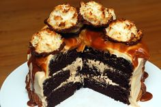 Triple Layer Chocolate Cake w/ Carmel Buttercream, Salted Caramel & Chocolate Dipped Coconut Macaroons by @hugs
