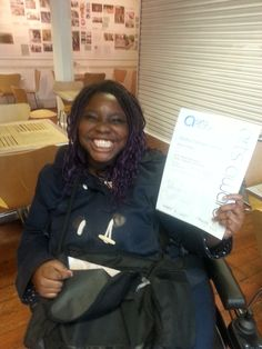 Participant recieving her Arts Awards Bronze Certificate
