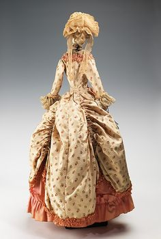 """1779 Doll""  Lucille Manguin   Designer: Alex Tonio (French) Date: 1949 Culture: French Medium: metal, plaster, hair, cotton, silk Dimensions: 34 x 10 in. (86.4 x 25.4 cm) Credit Line: Brooklyn Museum Costume Collection at The Metropolitan Museum of Art, Gift of the Brooklyn Museum, 2009; Gift of Syndicat de la Couture de Paris, 1949"