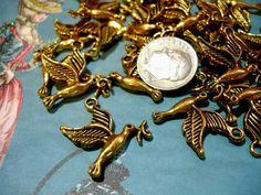 4 Antiqued Gold Hummingbird, Dove or Mockingjays. Starting at $1 on Tophatter.com!