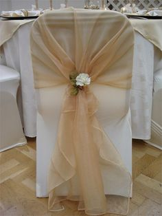 ivory chair cover with gold organza sash and ivory rose tieback decoration from pumpkin events - Rose Gold Wedding Chairs Covers Wedding Chair Decorations, Wedding Chairs, Wedding Centerpieces, Wedding Table, Wedding Chair Sashes, Wedding Ideas, White Chair Covers, Table Covers, Chair Bows