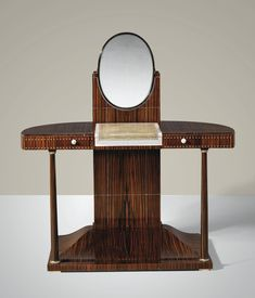 JACQUES EMILE RUHLMANN 1879 - 1933 'COLONETTES', A MACASSAR EBONY VENEER, IVORY, SHAGREEN AND SILVERED BRONZE COIFFEUSE BY JACQUES-EMILE RUHLMANN, THE DESIGN CIRCA 1919, THE PRESENT MODEL 1925.