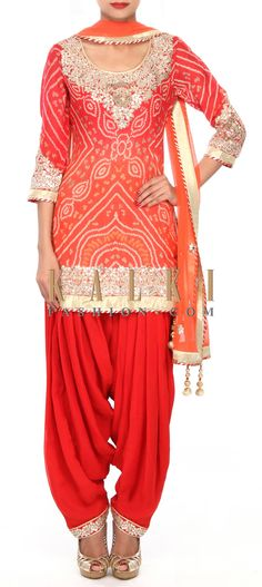Buy Online from the link below. We ship worldwide (Free Shipping over US$100) Price- $389.00 Click Anywhere to Tag http://www.kalkifashion.com/orange-patiala-suit-embellished-in-gotta-applique-embroidery-only-on-kalki.html
