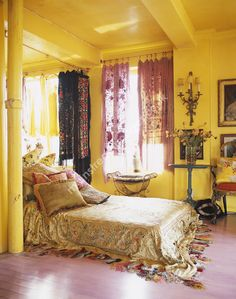 Shawls as window drapes.Betsey Johnsons home