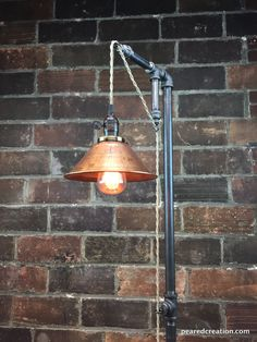 "This industrial steampunk floor lamp was designed with versatility in mind. The fixture has a built in an adjustable pendant that can be set to your desired height and easily changed whenever you wish. This simple steampunk floor lamp is full of character and vintage charm.  It starts with the 8"" #Copper #Edison #Farmhousedecor #Floorlamp #Handmadelighting #Industrial #Lamp #Lampshade #Lightbulb #Lightfixture #Lighting #Lightingdesign #Metallic #Patio #Pendantlamp #Recycle #S"
