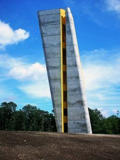 Holzer Kobler Architekturen observation tower of the Arche Nebra. Divided by a vertical crevice extending over its full height to mark the summer solstice, functioning as a solar calendar. Located close by (Wangen im Allgäu).