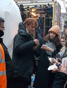 FANS' DELIGHT Outlander stars Sam Heughan and Catriona Balfe mobbed by fans while filming series three in Edinburgh