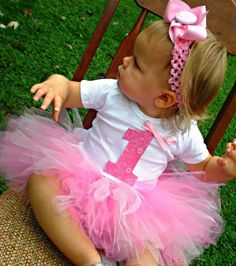 Baby Girl First Birthday Tutu Outfit with Headband and Flower Clip - Ready to ship in three days. $36.50, via Etsy.