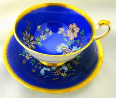 Paragon royal blue butterfly scene heavy brushed gold Tea cup and saucer