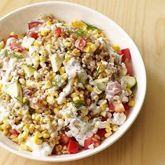 This fiber-rich salad combines fresh summer vegetables and farro with a creamy dill dressing. Out of season, use cooked frozen corn and halved grape tomatoes.#recipe #WWLoves