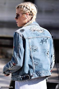 "An embellished denim jacket featuring assorted graphics such as ""Do Not Disturb Me"", ""Blah Blah Blah"", ""Someone Famous"", dice on the front, ""Miss You Bad"", and ""Love"" on the long sleeves, ""Authentic"", Girl Gang"", and heart graphics on the back, a basic collar, buttoned front, flap chest pockets, front welt pockets, and interior slip pockets."