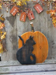 A personal favorite from my Etsy shop https://www.etsy.com/listing/541964696/rustic-halloween-black-cat-and-pumpkin
