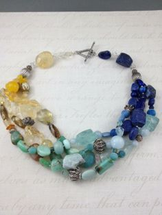 Yellow to Blue mutistrand includes, Citrine, Turquoise, Chrysoprase, Aquamarine, Lapis Lazuli and Sterling Silver collected from Oman, Morocco and Turkey
