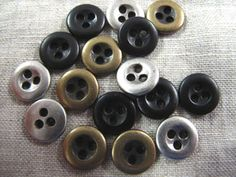 Were seeing lots of metal shirt buttons on ready to wear garments these days, so these Italian buttons are right on trend. Three holes makes them so unique!
