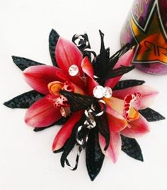 pink and black prom corsage with orchids and crystals by @Marilyn Dahn #prom #corsage