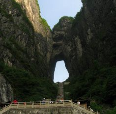 """Tianmen Mountain is a mountain located in northwestern Hunan Province, China.  It is also known as Heaven Gate Mountain due to a large natural ark, many Chinese people believe that the Tianmen Mountain is the """"Closest Earth Landmark to God""""."""