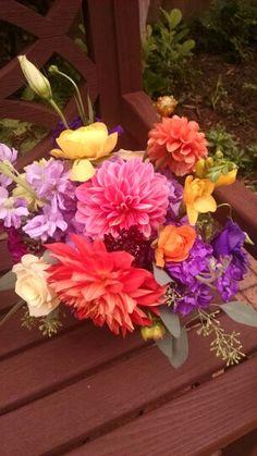 Bouquet of brilliant colored dahlias, roses, freesia, rananculus, stock, seeded eucalyptus.  In Bloom, Ltd.