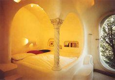bedroom in eco underground house in switzerland by vetsch architektur