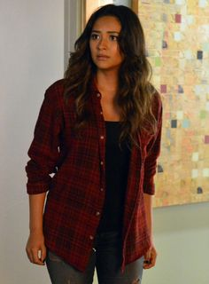 Emily wearing red plaid flannel jacket with black tank top and jeans