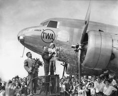 """Sept. 8, 1934: The World War I """"Ace of Aces"""" Eddie Rickenbacker helped Ruth Ann Faust christen a new TWA (Transcontinental Western Air) plane in Camden, N.J. Two months later, Captain Rickenbacker broke his own record for a transcontinental flight, flying another TWA plane from Burbank, Calif., to Newark, covering 2,609 miles in 12 hours 3 minutes 50 seconds. Photo: The New York Times"""