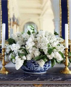 Habitually Chic®: Beautiful Blue & White. Three of my favorite things ... white lilacs, brass candlesticks and (sigh), blue porcelain!