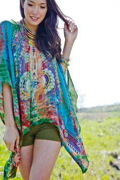 Tie Dye Dashiki Poncho from Earthbound Trading Co. Cute army green shorts and layered boho collar.