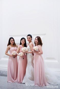 Keep your leading ladies pretty in pink with these blush coloured #bridesmaiddresses | Photography by: Hong Photography and Cinema Inc. | WedLuxe Magazine | #WedLuxe #Wedding #luxury #weddinginspiration #luxurywedding #bridesmaiddress #blushbridesmaiddress