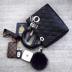 #whatsinmybag Lady Dior Bag with some goodies inside: Celine sunglasses, Louis Vuitton key pouch, Fur Pom
