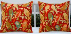 I bought these pillow covers on Etsy from the shop FestiveHomeDecor.  Bird prints, several  patterns, and the colors in these are key to  the decor of my living room.