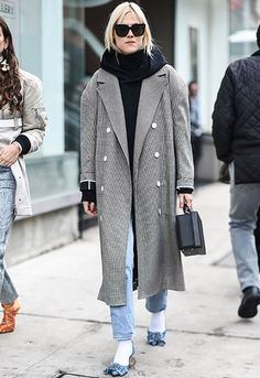 Linda Tol in an oversized coat and hoodie at NYFW | ASOS Fashion & Beauty Feed