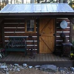 Cozy Cabin This West Virginia styled log cabin is home to a riding mower, and was built from scratch by the homeowner's son, on a concrete slab that was once a dog run. Double doors on the side allow easy access in and out. It's decorated to wild perfection— with water pump and a wood stove from the original home site.