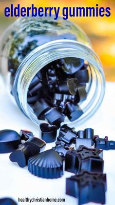 Kids (and grown ups) LOVE these cute and delicious elderberry gummies! These are the most fun way to boost your immune system and protect agains colds and viruses! Make a batch today to add to your cold remedies stash. #elderberrygummies #elderberry #elderberries #coldremedy #coldremedies #coldremediesfastfeelbetter #remedies #remedy #immunesupport #immune #gummies