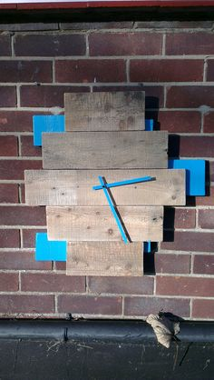 Hand made funky clock, made from pallets.
