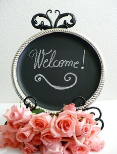 """Chalkboard """"Welcome!"""" sign for wedding."""