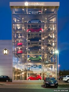 Landscape or carscape? From the BBC, a car showroom in Scotland, made of clear glass with an elevator that can retrieve a car in 1 minute.From the BBC, a car showroom in Scotland, made of clear glass with an elevator that can retrieve a car in 1 minute. Parking Building, Car Parking, Car Repair Service, Auto Service, Parking Solutions, Showroom Design, Car Museum, Parking Design, Motorcycle Design