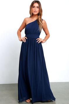 It will be hard not to admire yourself in every passing reflection while you don the Looking Glass Navy Blue One-Shoulder Maxi Dress! Woven fabric drapes to a billowy, banded waist from a ruched, one-shoulder bodice, while a full maxi skirt descends below. Hidden side zipper with clasp.