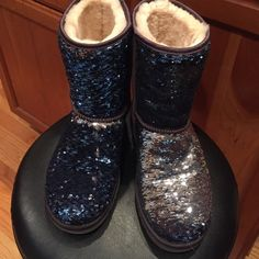UGG short sparkle boots Classic short boots with two-toned sequins make these boots shine! Brush them down, they're blue.  Brush up, they're silver. Only worn inside as slippers, never touched outdoors! PRICE FIRM. UGG Shoes Winter & Rain Boots