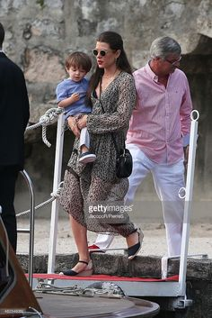 Charlotte with her son arriving on the island for the pre-wedding party of her brother Pierre and Beatrice