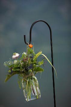 wildflowers on a shepherd's hook