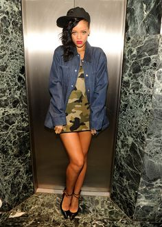 Rihanna in a camo print mini during her 777 Tour
