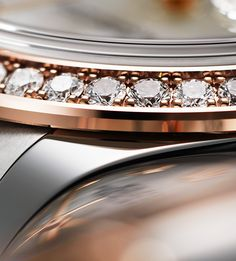 The precise gem-setting of perfectly aligned diamonds on a Rolex Lady-Datejust bezel. Perfection is in the details.