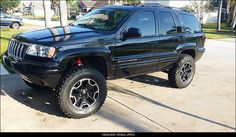 asome pic...  black limited jeep wj lift kit and rubicon wheels