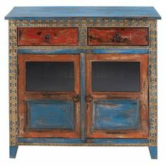 "Wood cabinet with a weathered multicolor painted finish and floral details.  Product: CabinetConstruction Material: WoodColor: Weathered multiFeatures: Two drawers and two doorsDimensions: 35"" H x 35"" W x 15"" D"