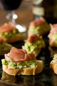 Avocado Proscuitto Crostini with Goat Cheese, Lime, and Fresh Pesto