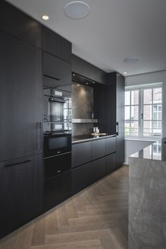 We combined two apartments on the Prinsengracht in Amsterdam to form one large penthouse apartment. Complete architectural remodeling and interior … Kitchen Room Design, Best Kitchen Designs, Home Room Design, Modern Kitchen Design, Home Decor Kitchen, Interior Design Kitchen, Home Kitchens, Brown Kitchens, Elegant Kitchens